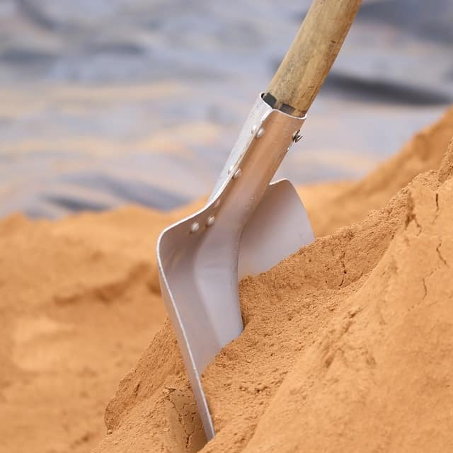 A square muck shovel with a rounded tip to make shoveling pond muck easier