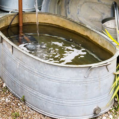 A container pond being created from a livestock watering trough