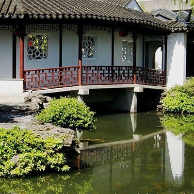 Traditional Chinese architecture and koi pond with native plants
