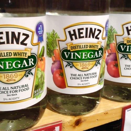 Bottles of Heinz white vinegar on a shelf